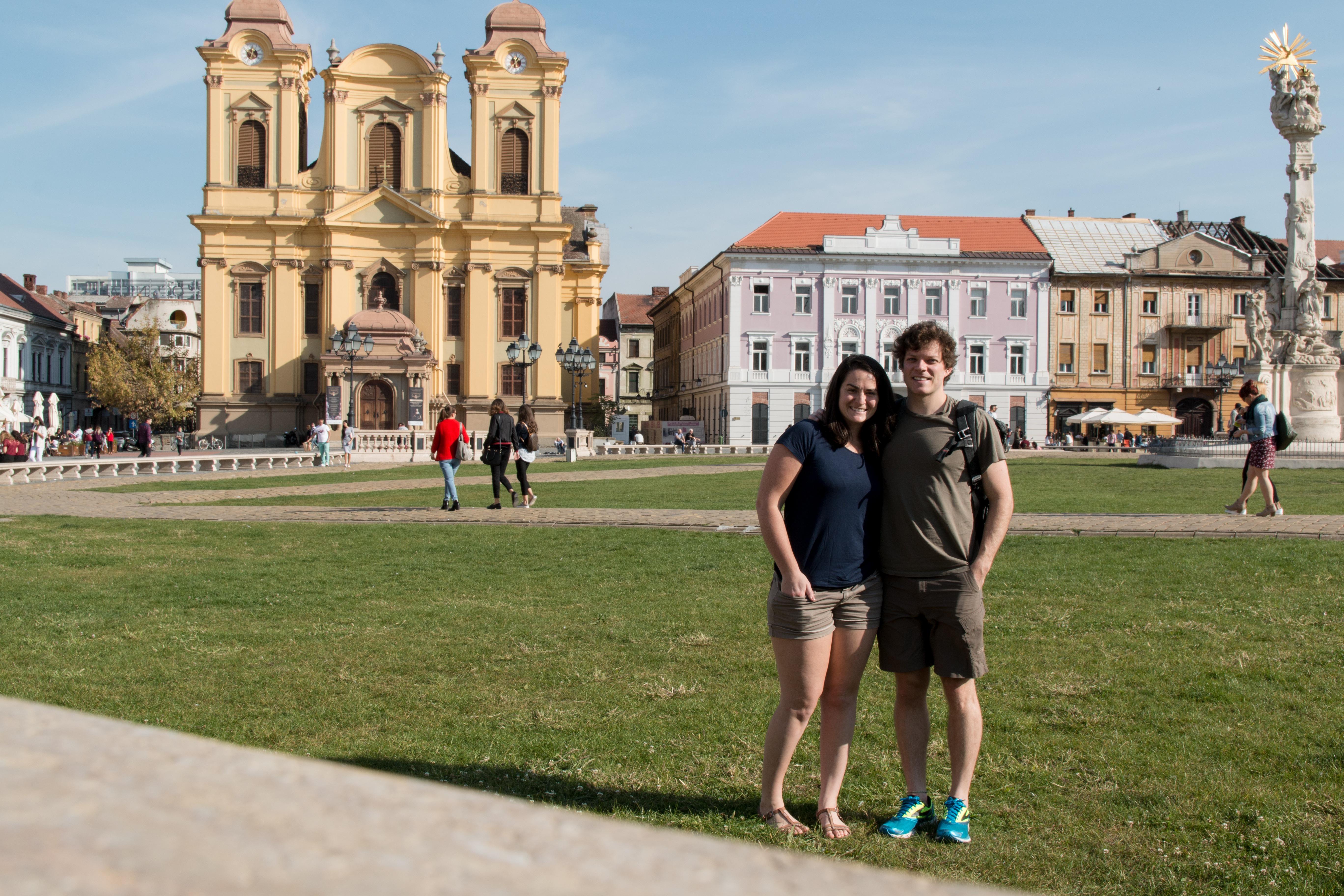 Timisoara, Romania, public Square, yellow church, arboursabroad, traveling couple